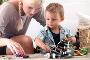 Babysitter on demand app: Professional hands taking care of your child